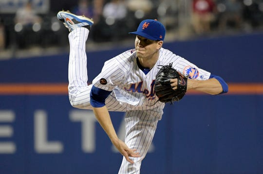 New York Mets pitcher Jacob deGrom delivers the ball to the Atlanta Braves during the first inning of a baseball game Wednesday, Sept. 26, 2018, in New York.