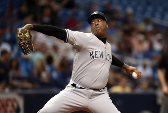 Sep 26, 2018; St. Petersburg, FL, USA; New York Yankees relief pitcher Aroldis Chapman (54) throws a pitch during the seventh inning against the Tampa Bay Rays at Tropicana Field.