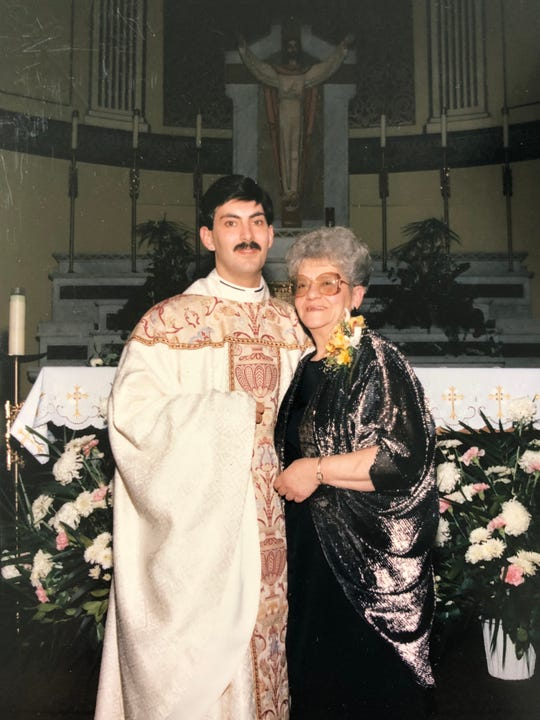 Reading with his mother after the ordination ceremony