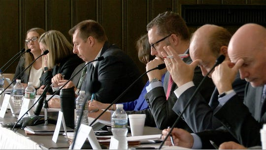 Members of the State Investment Council listen to former are shown during their meeting at the War Memorial Thursday, September 27, 2108.