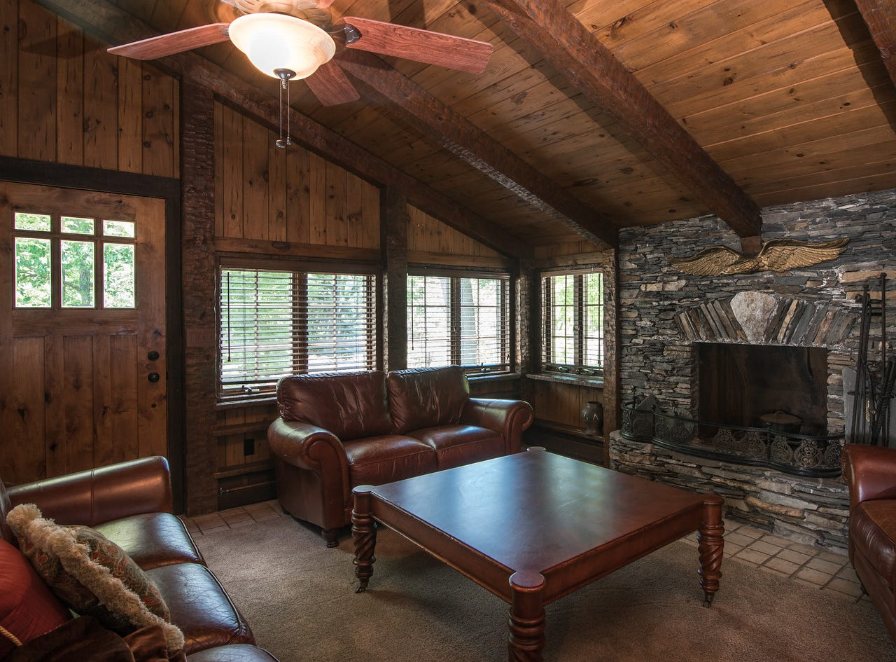 A wood-paneled den is one of 24 rooms in the estate on the shore of Greenwood Lake in New York State, which has been listed for sale at $14.75 million.