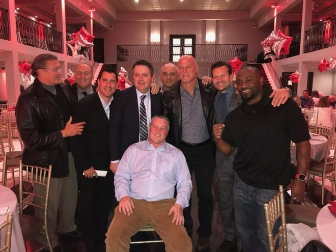 Coach Chet Parlavecchio (third from right) and current Belleville football coach Jermain Johnson, who played on the 1988 Bloomfield team (far right), at a celebration for that squad last year.