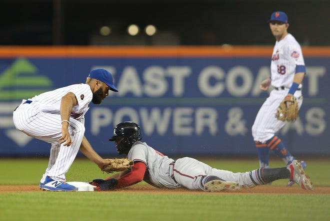 Sep 26, 2018; New York City, NY, USA; Atlanta Braves left fielder Ronald Acuna Jr. (13) steals second base ahead of the tag by New York Mets shortstop Amed Rosario (1) during the first inning at Citi Field. Mandatory Credit: Brad Penner-USA TODAY Sports