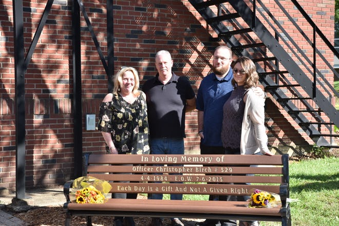 Midland Park dedicated a memorial bench to Officer Chris Birch, who died in an ATV accident at the age of 31 in 2015. His family Danna, Jim, Cory and Meagan Birch, pose for a photo.