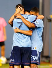 Sep 26, 2018; New York, NY, USA; New York City forward David Villa (7) celebrates with midfielder Ismael Tajouri (29) and midfielder Maximiliano Moralez (10) after scoring a goal against Chicago Fire during second half at Yankee Stadium. Mandatory Credit: Noah K. Murray-USA TODAY Sports
