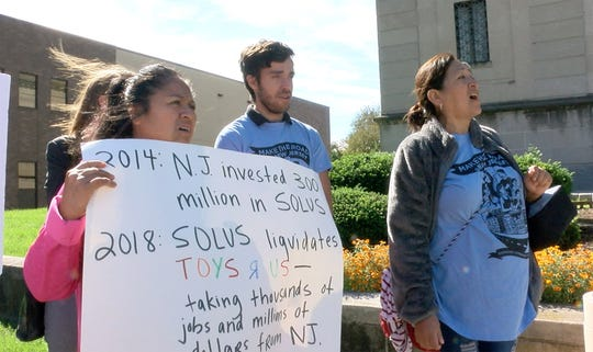 People protest outside the State Investment Council meeting at the War Memorial Thursday, September 27, 2108, where former Toys 'R Us employees testified.