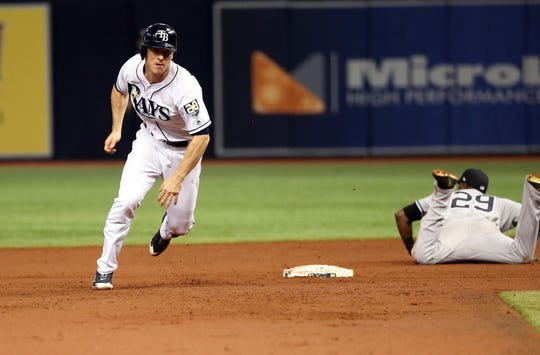 Sep 26, 2018; St. Petersburg, FL, USA; Tampa Bay Rays third baseman Joey Wendle (18) runs to third base as New York Yankees shortstop Adeiny Hechavarria (29) misses the ball on a error by New York starting pitcher Masahiro Tanaka (not pictured) during the first inning at Tropicana Field.