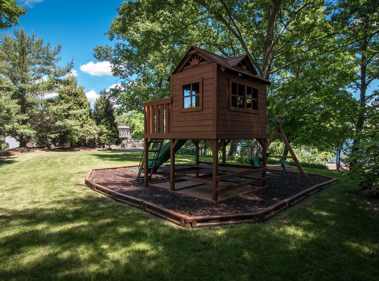 A playground and clubhouse sit in the backyard of a 24-room estate on the shore of Greenwood Lake in New York State, which has been listed for sale at $14.75 million.