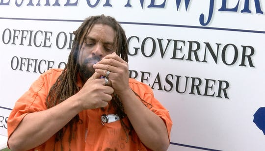 Ed Forchion, known best as NJ Weedman, lights up a marijuana cigarette outside the Governor's office on West State Street in Trenton Thursday, September 27, 2018.  He billed this as his boldest stunt - selling marijuana outside the Statehouse while daring police to arrest him.