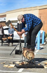 Lumberjack Dave Weatherhead of Timberworks Jackshow.com from Wisconsin, competes in a wood chopping during the opening day for Duluth Trading Company in Ramsey on 09/27/18.