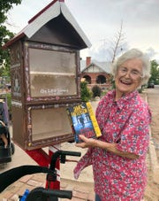 Thelma Moore keeps tabs on her lending library at 613 S. Iron St. Give a book and take a book.
