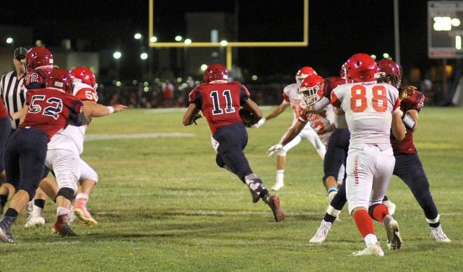 The Deming offensive line created huge running lanes for senior back Nicholas Soledad (11) to run through last week against Cobre High.