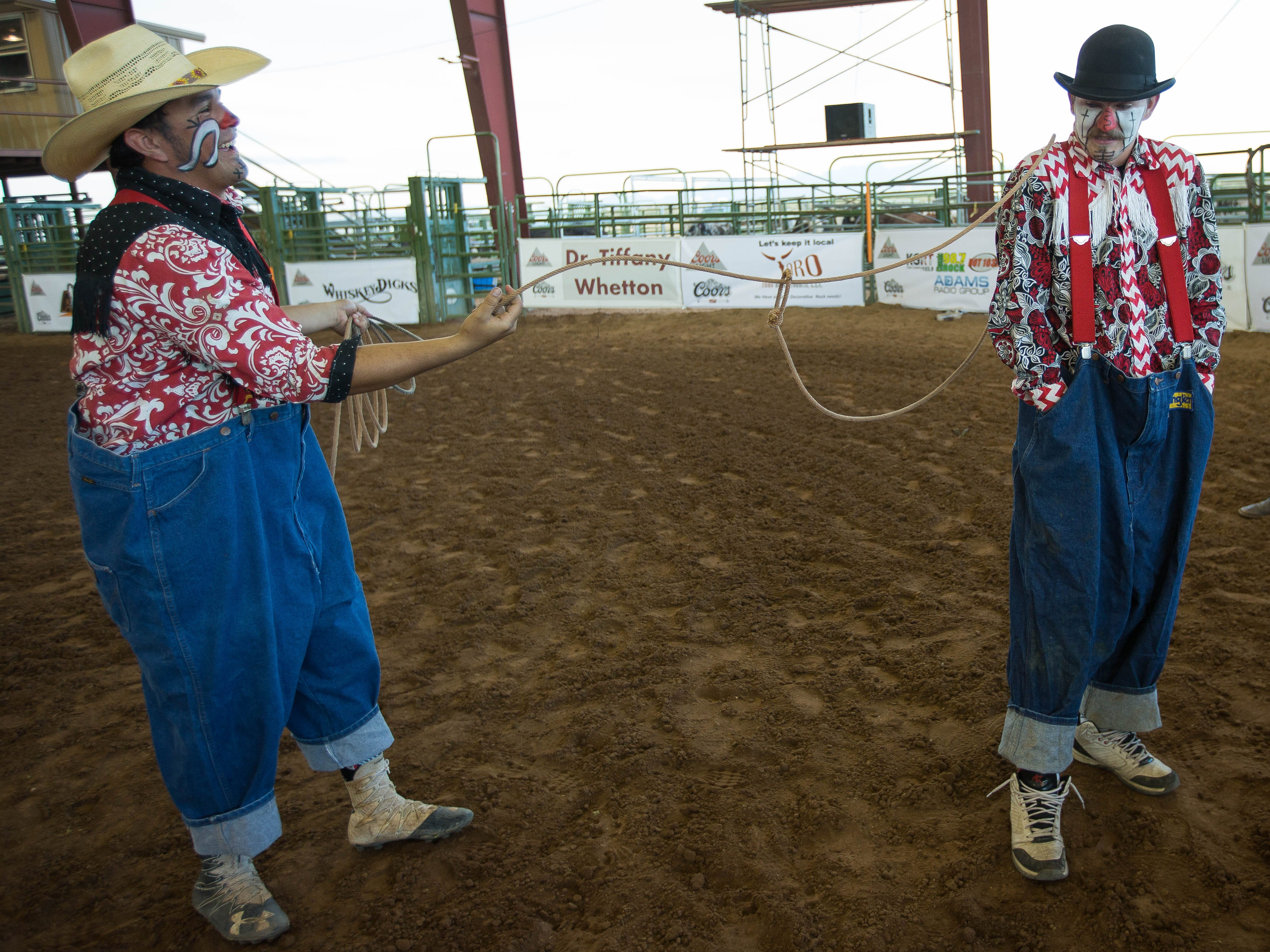 Josh Hernandez, left, ropes his friend and fellow rodeo clown Ethan Johnson, right, in the Kids and Fan Zone at the Southern New Mexico State Fair and Rodeo, Wednesday September 26, 2018.