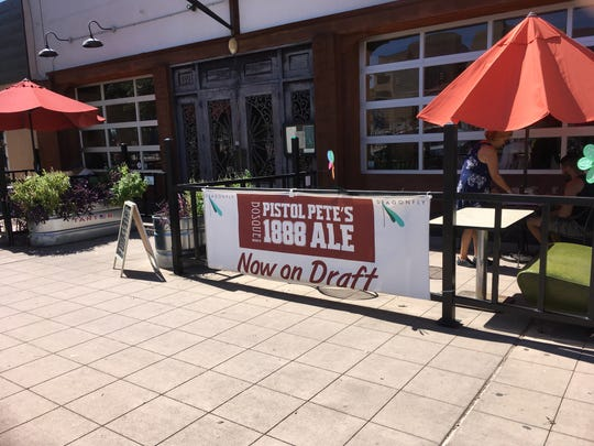 A canvas banner promoting Pistol Pete's 1888 ale displayed in front of downtown Las Cruces restaurant Dragonfly on September 27, 2018.