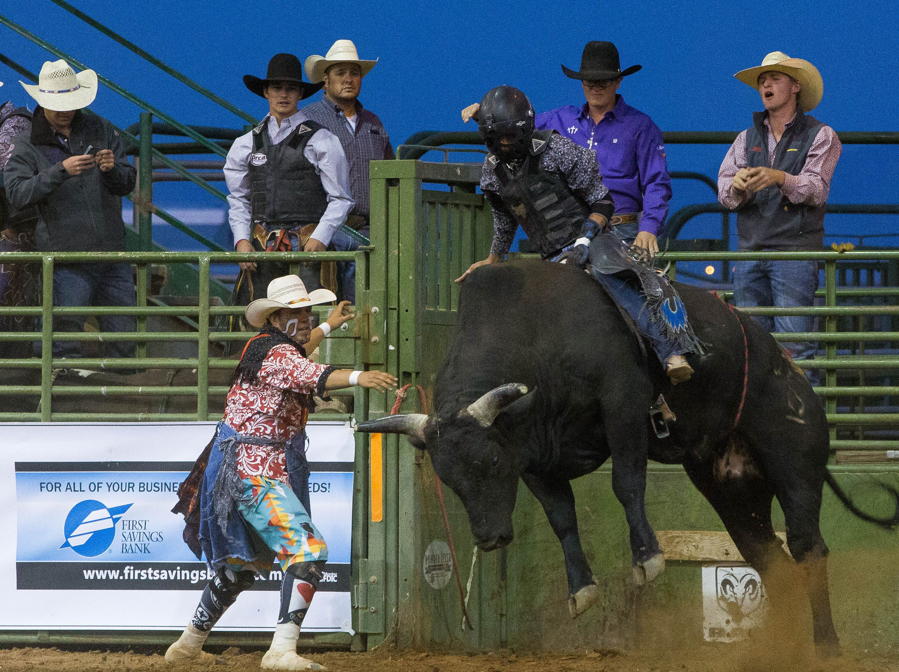 """Shannon Terrazas, comes out of the shoot riding """"Smokin' Fool,"""" during the first round of the Rumble on the Rio Bull riding competition at the Southern New Mexico State Fair and Rodeo, Wednesday September 26, 2018."""
