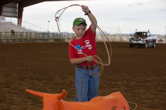 Brody Card, 10, works on his lasso-throwing technique Wednesday Sept. 26, 2018 at the Kids and Fans Zone, part of the Southern New Mexico State Fair and Rodeo.
