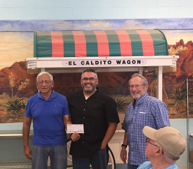 After successfully closing on property owned by El Caldito Soup Kitchen, Las Cruces Realtor Steve Montanez presented a check back to El Caldito in the amount of $811 on Sept. 19.