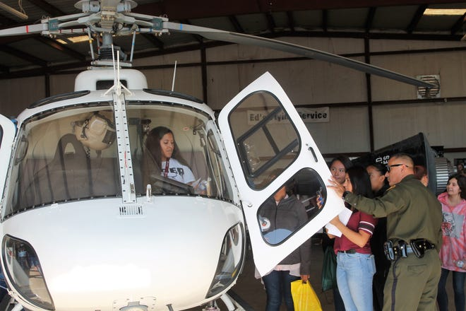 A student seeing how it feels in the Border Patrol helicopter at the 2018 NMAAA STEM Expo at the Alamogordo White Sands Regional Airport Thursday.