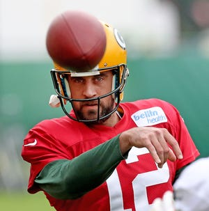 Green Bay Packers quarterback Aaron Rodgers (12) throws a drill toss during practice on Clarke Hinkle Field Thursday, September 27, 2018 in Ashwaubenon, Wis