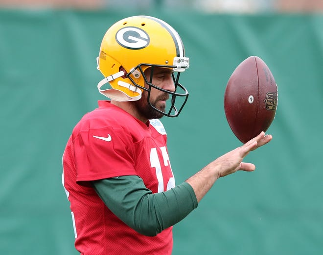 Green Bay Packers quarterback Aaron Rodgers (12) balances a ball on his hand during practice on Clarke Hinkle Field Thursday, September 27, 2018 in Ashwaubenon, Wis