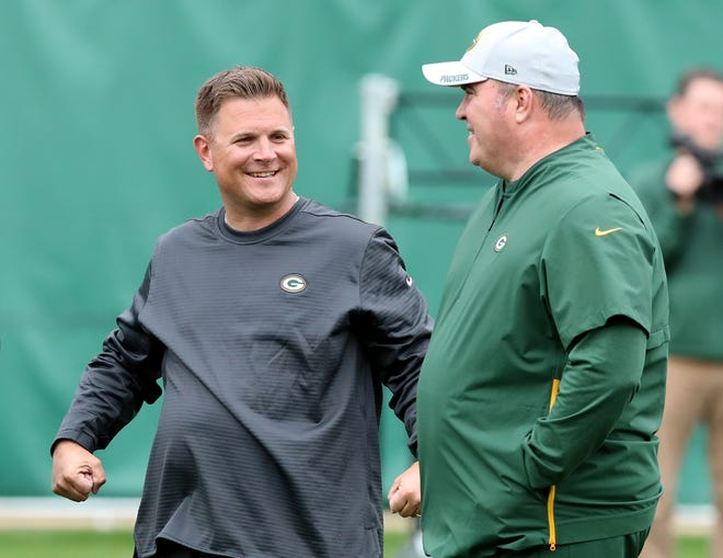 Packers general manager Brian Gutekunst and head coach Mike McCarthy talk during practice on Clarke Hinkle Field Thursday, September 27, 2018 in Ashwaubenon, Wis