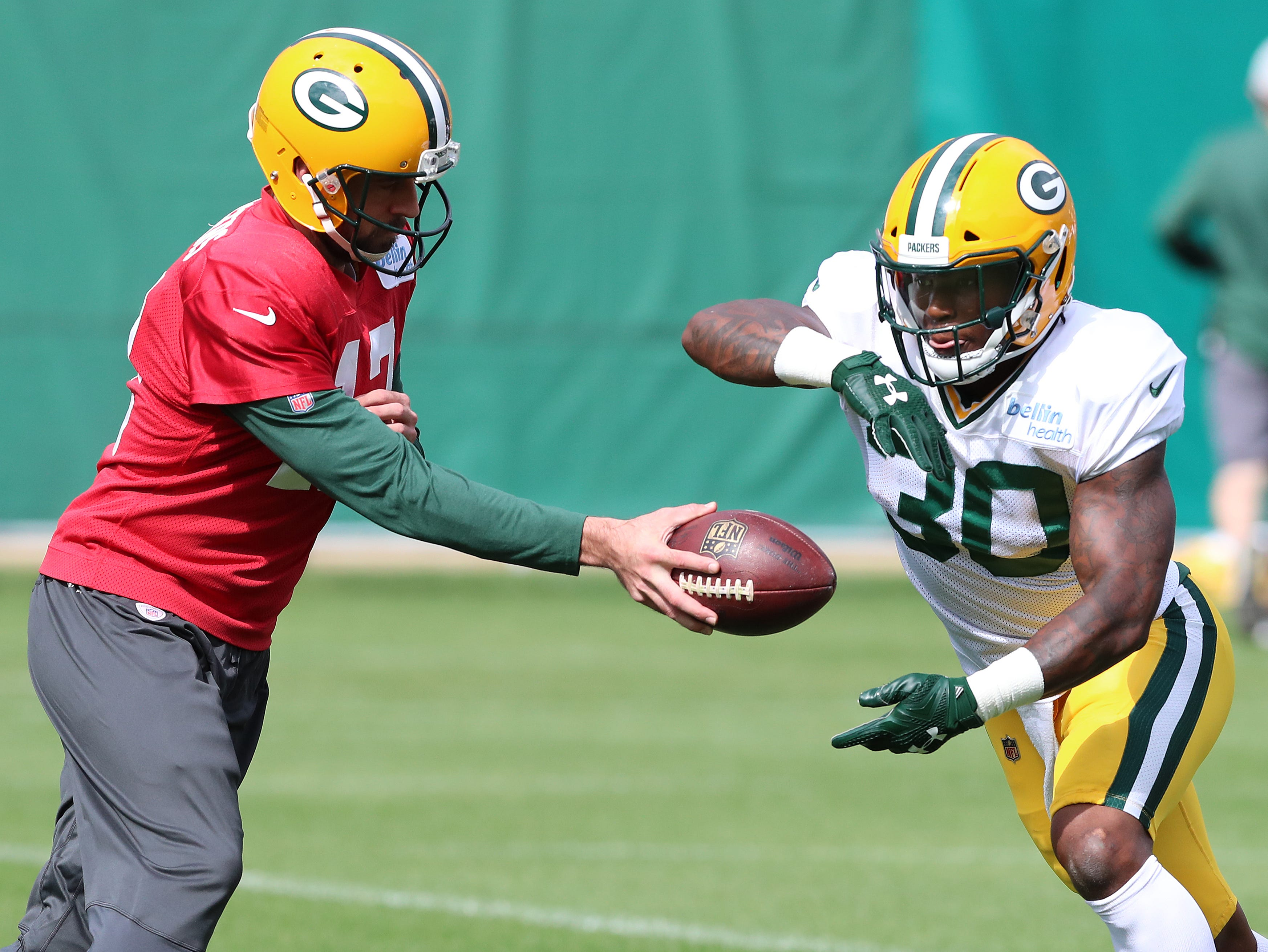 Green Bay Packers quarterback Aaron Rodgers (12) hands off to running back Jamaal Williams (30) during practice on Clarke Hinkle Field Thursday, September 27, 2018 in Ashwaubenon, Wis