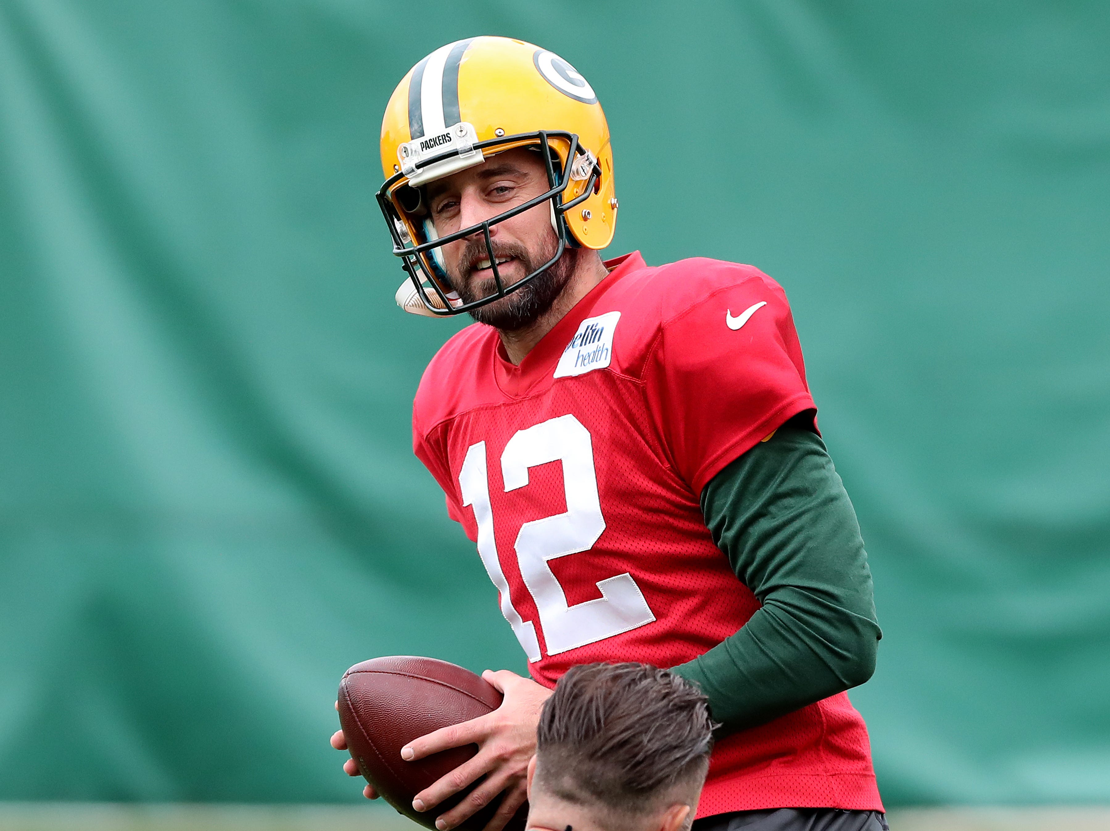 Green Bay Packers quarterback Aaron Rodgers (12) takes a practice snap during practice on Clarke Hinkle Field Thursday, September 27, 2018 in Ashwaubenon, Wis