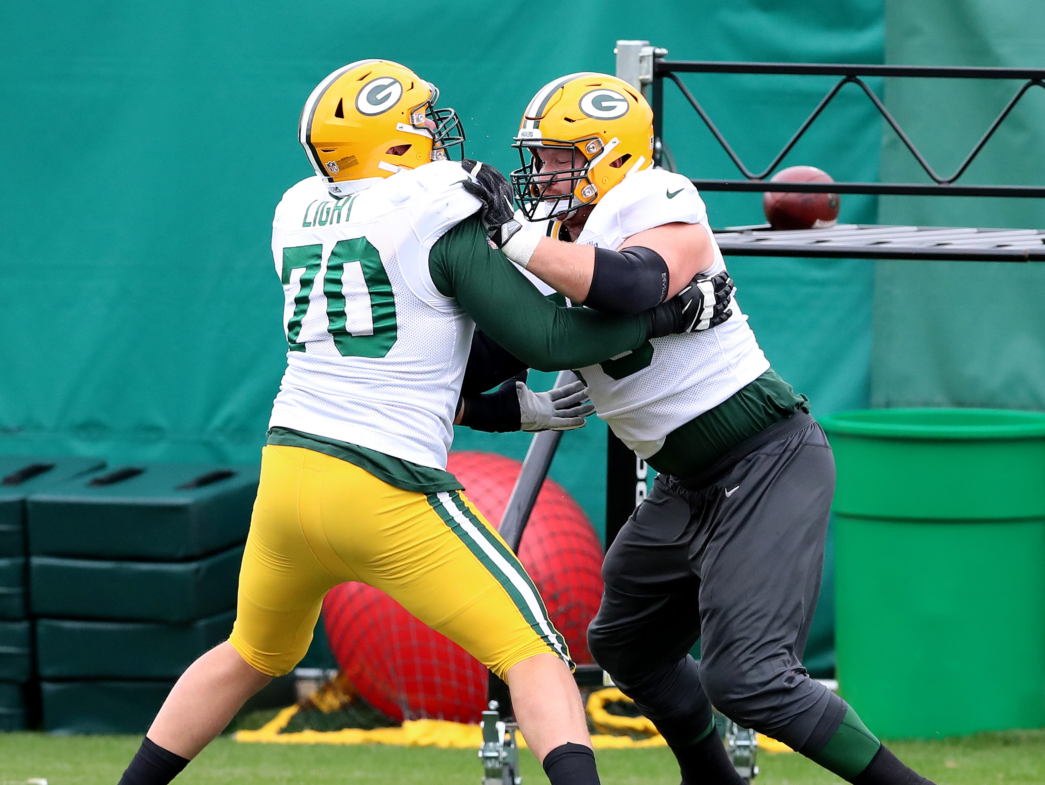 Green Bay Packers offensive tackle Bryan Bulaga (75) drills with offensive guard Alex Light (70) during practice on Clarke Hinkle Field Thursday, September 27, 2018 in Ashwaubenon, Wis