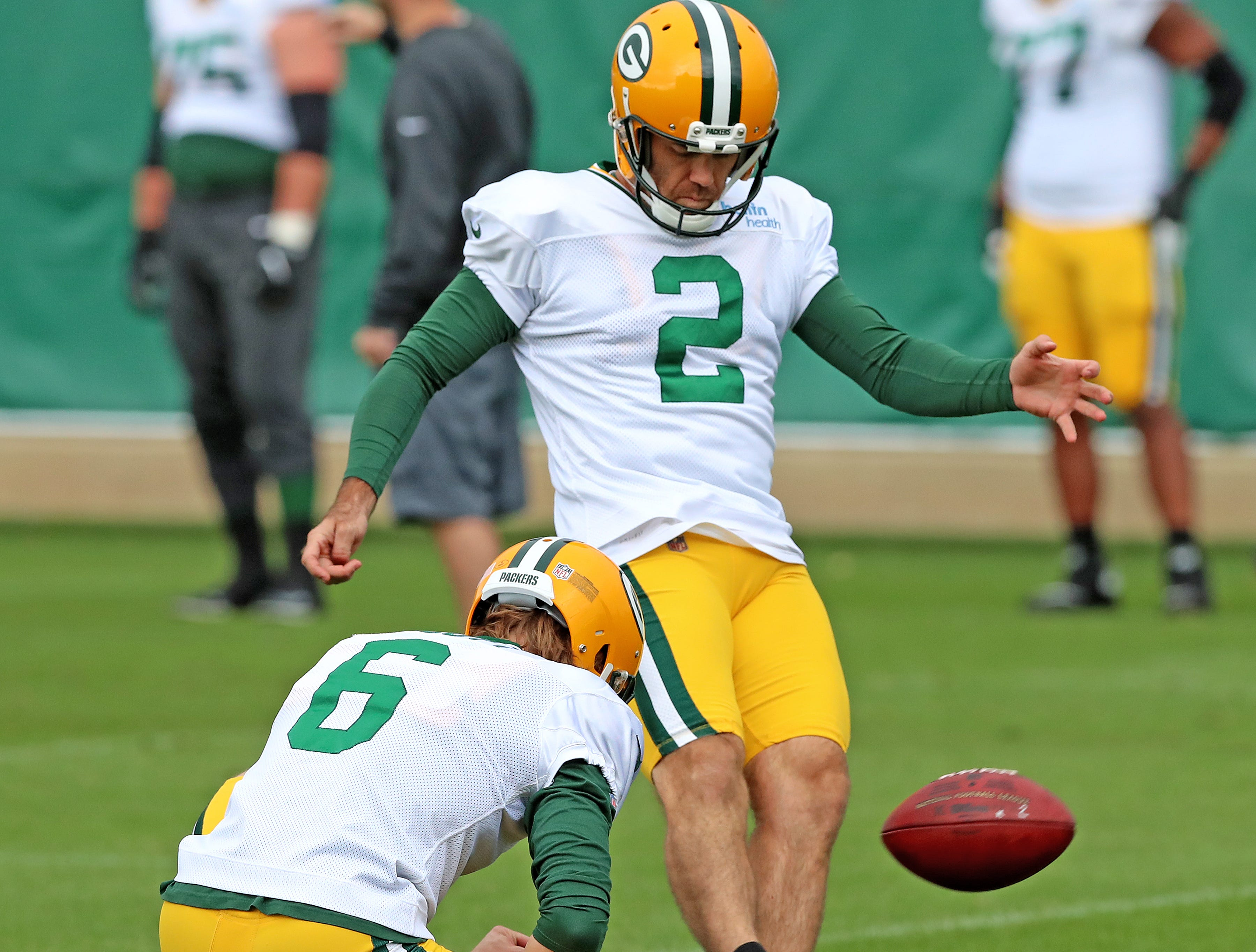 Green Bay Packers kicker Mason Crosby (2) kids from the hold of punter JK Scott (6) during practice on Clarke Hinkle Field Thursday, September 27, 2018 in Ashwaubenon, Wis