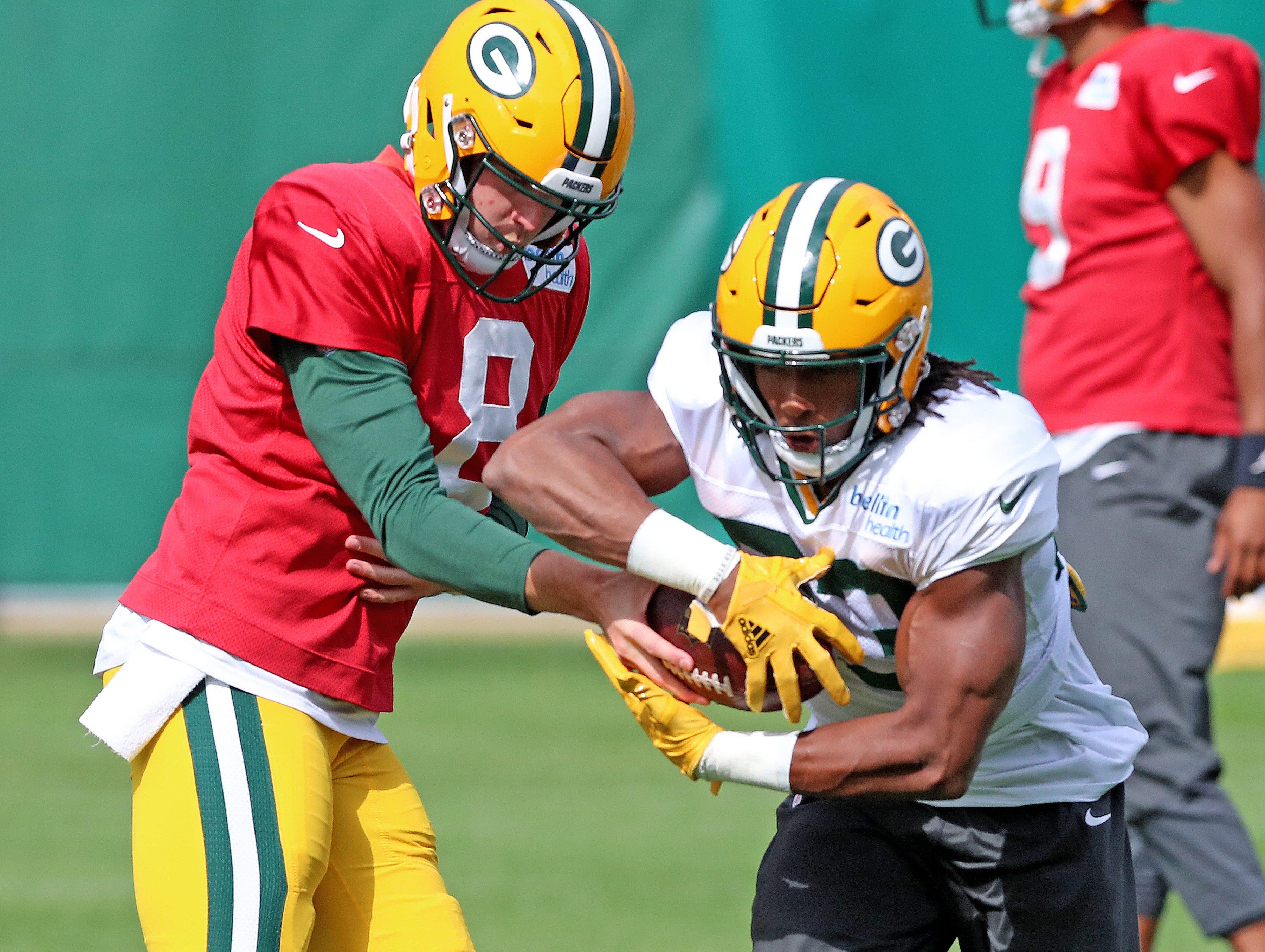 Green Bay Packers quarterback Tim Boyle (8) hands off to running back Aaron Jones (33) during practice on Clarke Hinkle Field Thursday, September 27, 2018 in Ashwaubenon, Wis