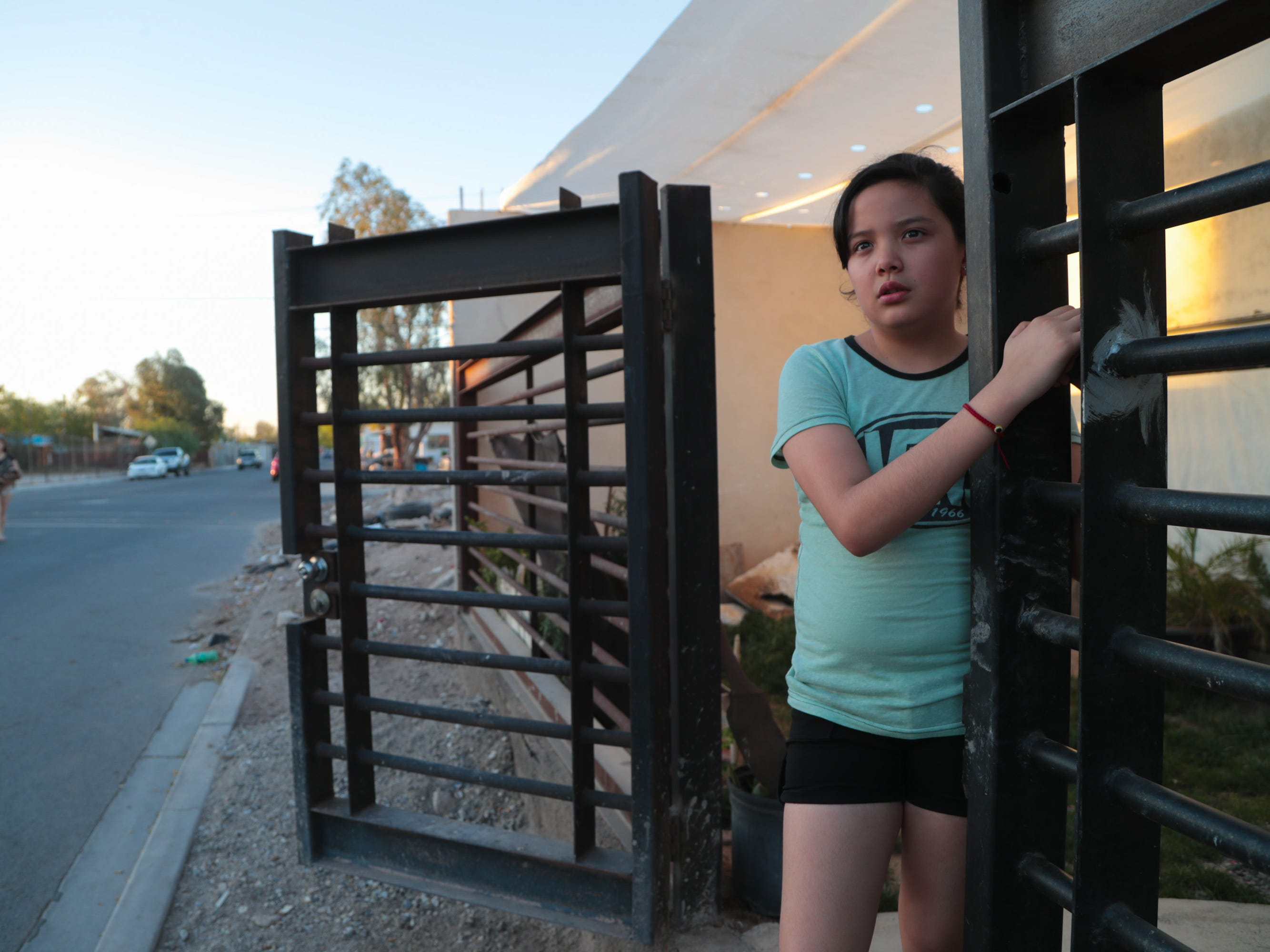 Pricila Lizarraga  stands outside her cousins' home in Mexicali.
