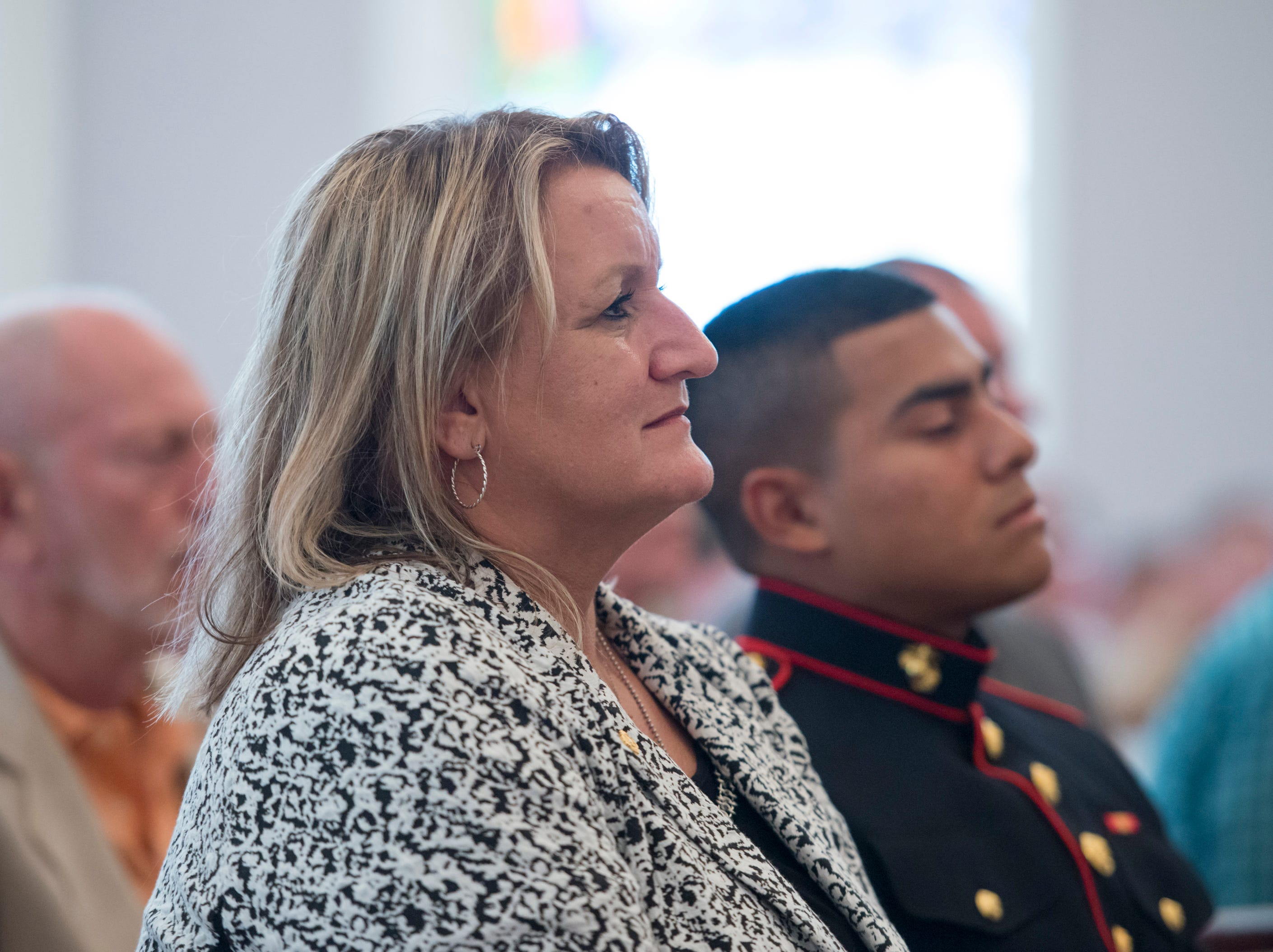 "JoAnn Boussouar, of Milton, listens during the Gold Star Program's ""Bells Across America for Fallen Service Members"" remembrance ceremony at the Naval Air Station in Pensacola on Thursday, September 27, 2018.  Boussouar lost her son - Missississippi National Guard Sgt. Kyle Thomas on Memorial Day in 2017.  Thomas was killed when his M1 Abrams Main Battle Tank overturned during an exercise preparing for deployment to the Middle East."