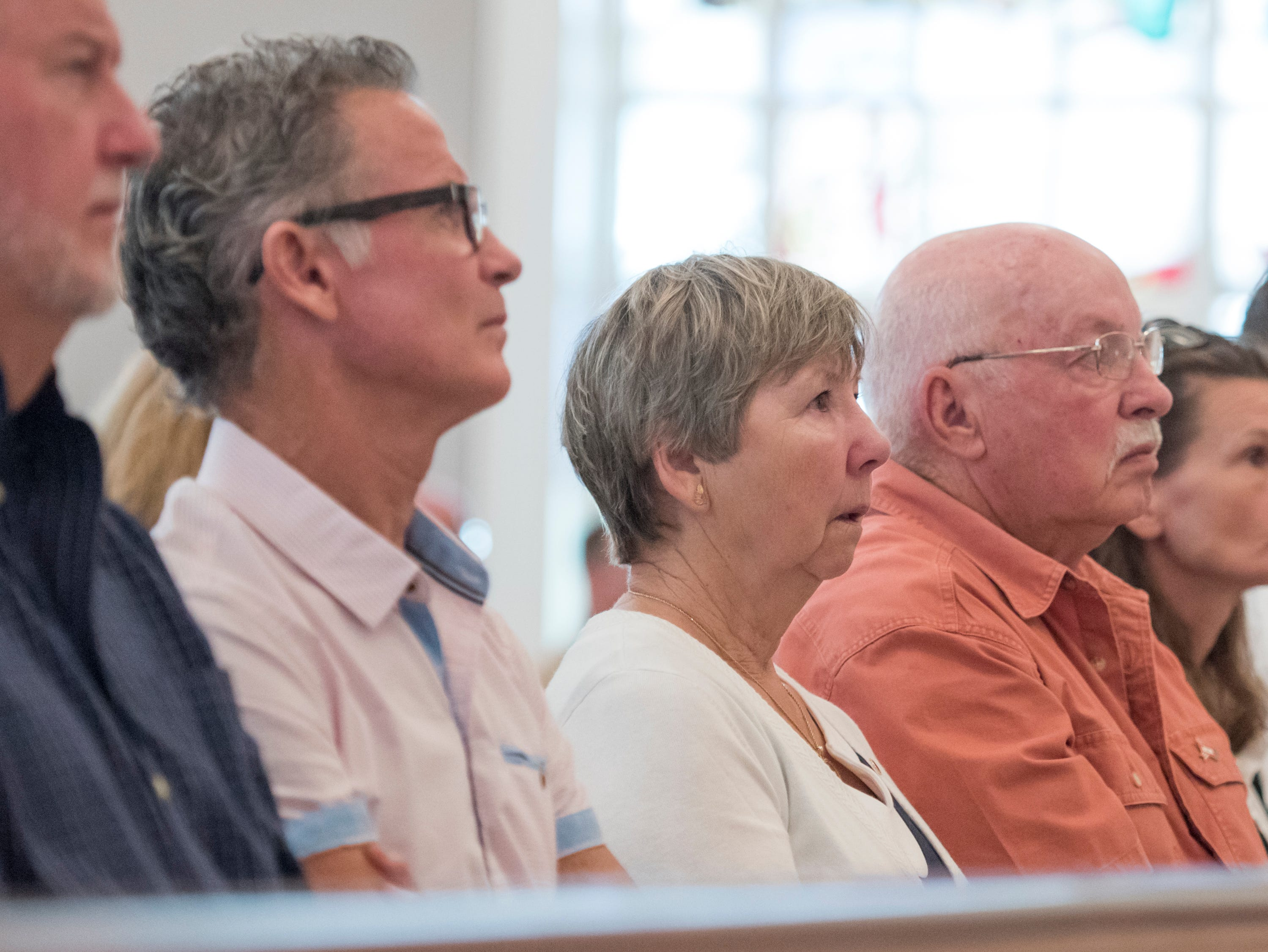 "Gold Star family members Dennis Brown, from left, Jeff Brown, Liane McCall, and Marvin McCall listen as names of fallen servicemen are read during the Gold Star Program's ""Bells Across America for Fallen Service Members"" remembrance ceremony at the Naval Air Station in Pensacola on Thursday, September 27, 2018.  The Brown's brother Marine Lance Cpl. Steven Brown died on July 4, 1967 and the McCall's grandson Army Sgt. Daniel McCall died in 2007."