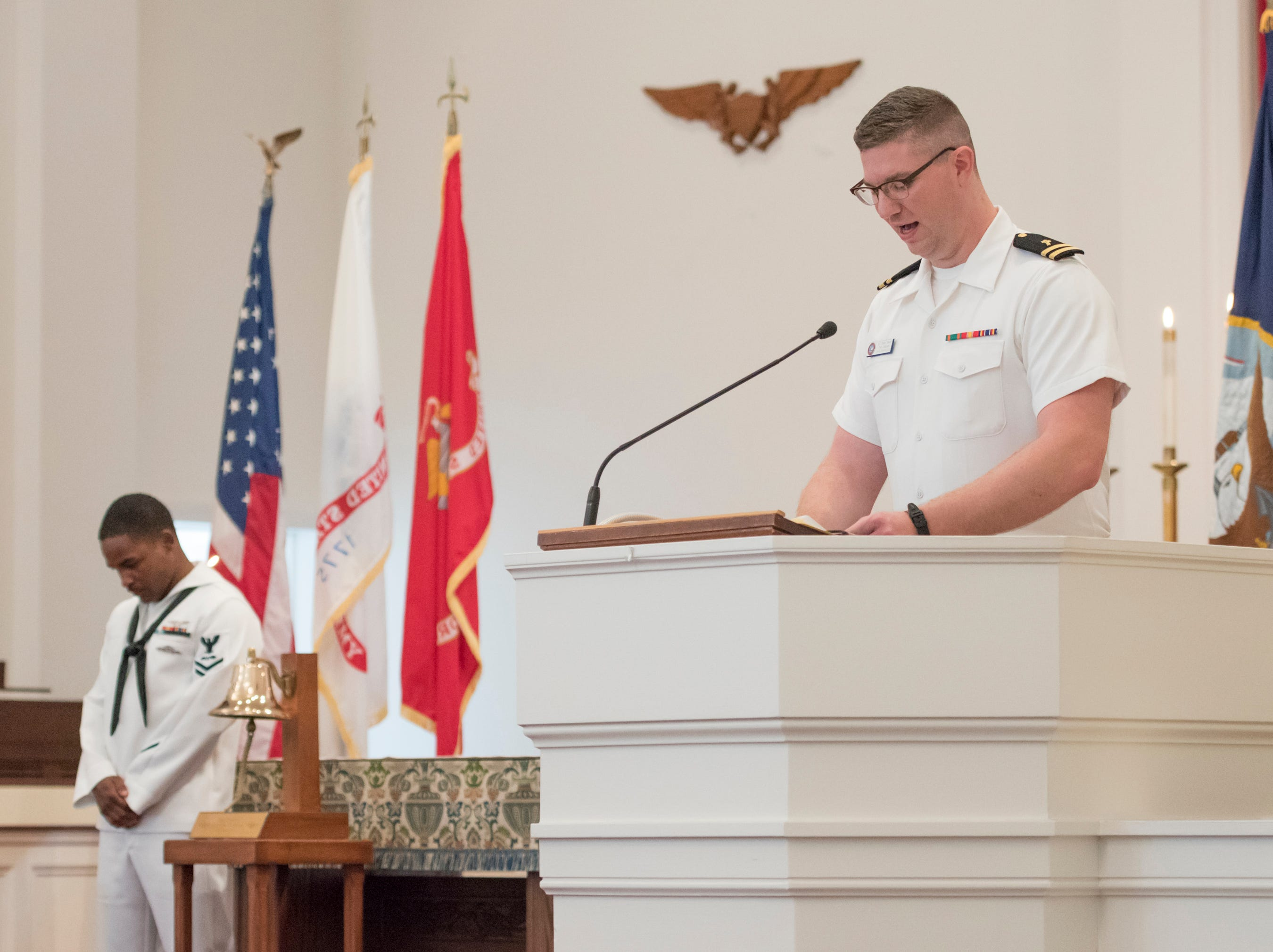 "Chaplain Terrell gives the invocation during the Gold Star Program's ""Bells Across America for Fallen Service Members"" remembrance ceremony at the Naval Air Station in Pensacola on Thursday, September 27, 2018."