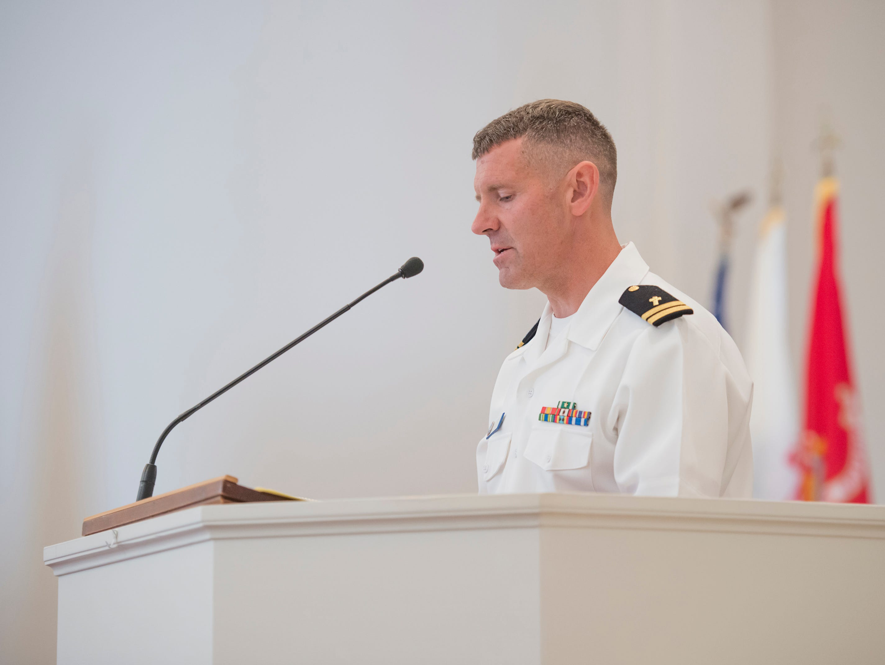 "Chaplain Tiff gives the benediction the during the Gold Star Program's ""Bells Across America for Fallen Service Members"" remembrance ceremony at the Naval Air Station in Pensacola on Thursday, September 27, 2018."