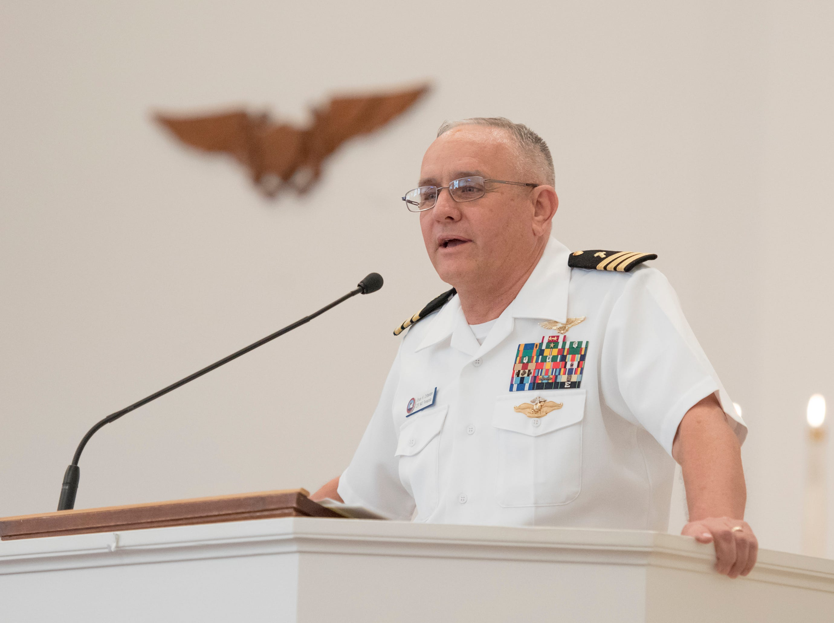 "Chaplain Bryan Crittendon speaks during the Gold Star Program's ""Bells Across America for Fallen Service Members"" remembrance ceremony at the Naval Air Station in Pensacola on Thursday, September 27, 2018."