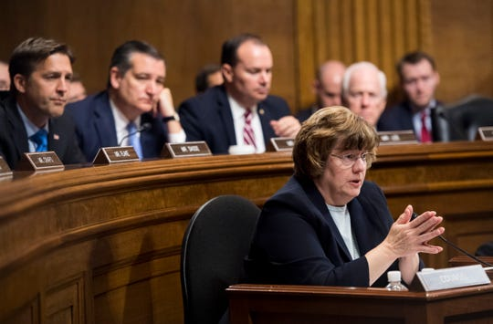 Arizona prosecutor Rachel Mitchell questions Christine Blasey Ford as Senators, from left: Sen. Ben Sasse, R-Neb.; Sen. Ted Cruz, R-Texas; Sen. Mike Lee, R-Utah.; and Sen. John Cornyn, R-Texas, listen during the Senate Judiciary Committee hearing, Sept. 27, 2018 on Capitol Hill in Washington.