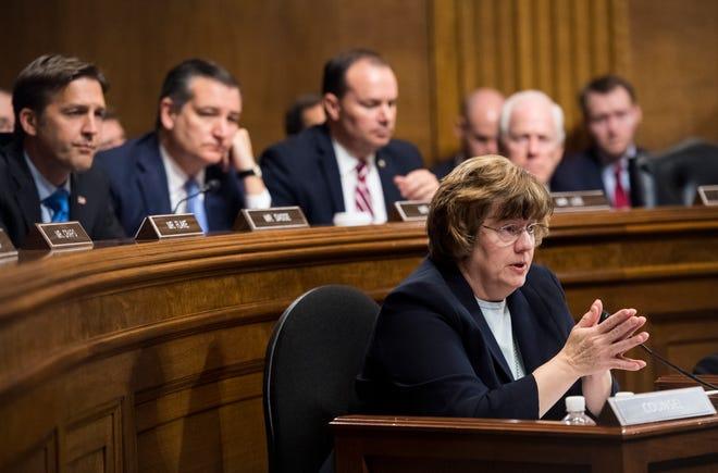 Arizona prosecutor Rachel Mitchell questions Christine Blasey Ford as Senators, from left: Sen. Ben Sasse, R-Neb.; Sen. Ted Cruz, R-Texas; Sen. Mike Lee, R-Utah.; and Sen. John Cornyn, R-Texas, listen during the Senate Judiciary Committee hearing, Sept. 27, 2018 on Capitol Hill in Washington.
