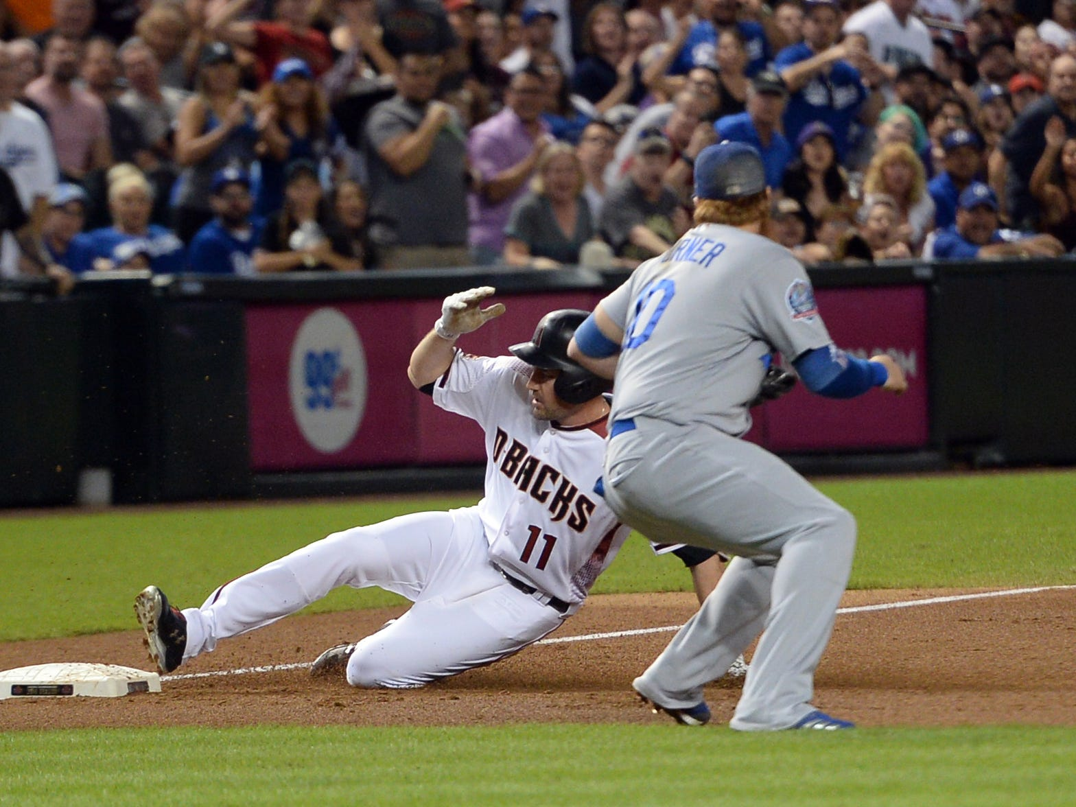 Sep 26, 2018; Phoenix, AZ, USA; Arizona Diamondbacks center fielder A.J. Pollock (11) slides into third base safely ahead of the tag of Los Angeles Dodgers third baseman Justin Turner (10) for a triple during the second inning at Chase Field.