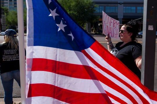 Sam Rude shows support for Supreme Court nominee Brett Kavanaugh outside Sen. Jeff Flake's office  on Sept. 27, 2018, in Phoenix.