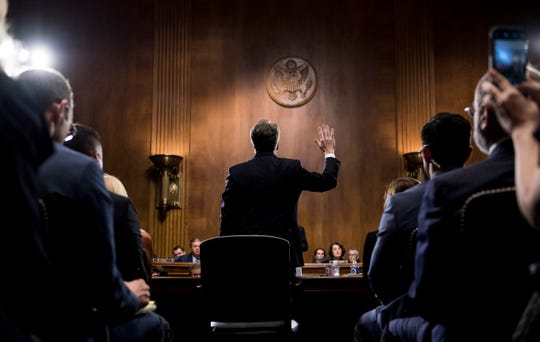 Supreme Court nominee Judge Brett Kavanaugh is sworn in before testifying during the Senate Judiciary Committee, Sept. 27, 2018 on Capitol Hill in Washington.