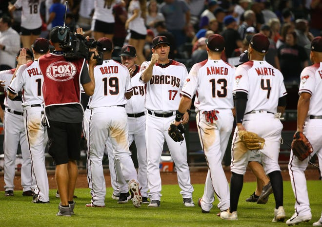 Arizona Diamondbacks celebrate their 7-2 victory over the Los Angeles Dodgers during the final home game of the season on Sep. 26, 2018, at Chase Field in Phoenix, Ariz.