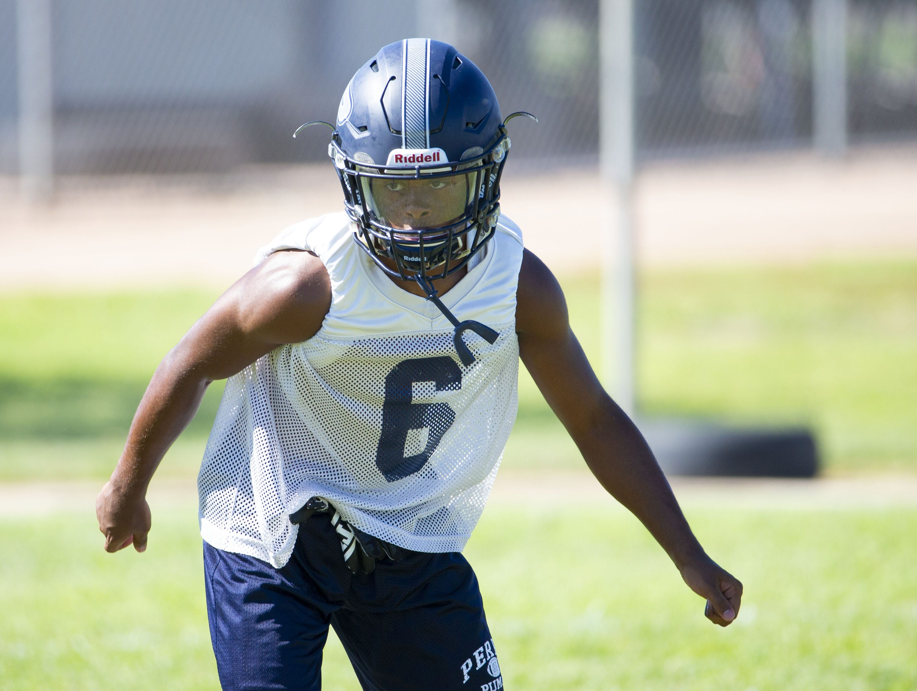 Perry High football wide receiver Jorden Young runs a play during practice in Gilbert on September 26,  2018.