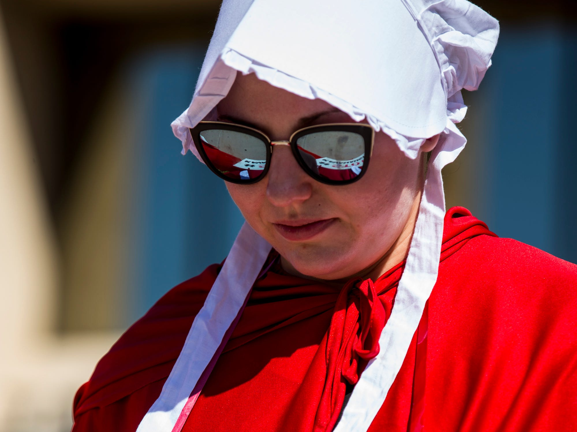 Kristin Clark, dressed as a handmaid, protests Supreme Court nominee Brett Kavanaugh outside Senator Jeff Flake's office on Sept. 27, 2018, in Phoenix.