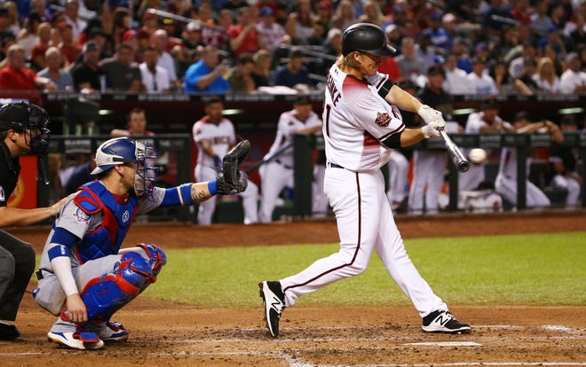 Arizona Diamondbacks Zack Greinke hits a single against the Los Angeles Dodgers in the second inning on Sep. 26, 2018, at Chase Field in Phoenix, Ariz.