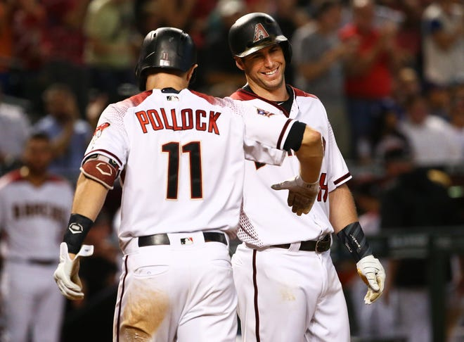 Arizona Diamondbacks Paul Goldschmidt smiles after A.J. Pollock hit a 3-run home run against the Los Angeles Dodgers in the fifth inning on Sep. 26, 2018, at Chase Field in Phoenix, Ariz.