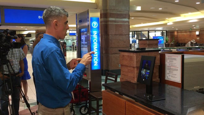 A demonstration of the new tablet in Terminal 4 at Phoenix Sky Harbor Airport which helps travelers who are deaf, hard of hearing or speech-challenged communicate with interpreters.