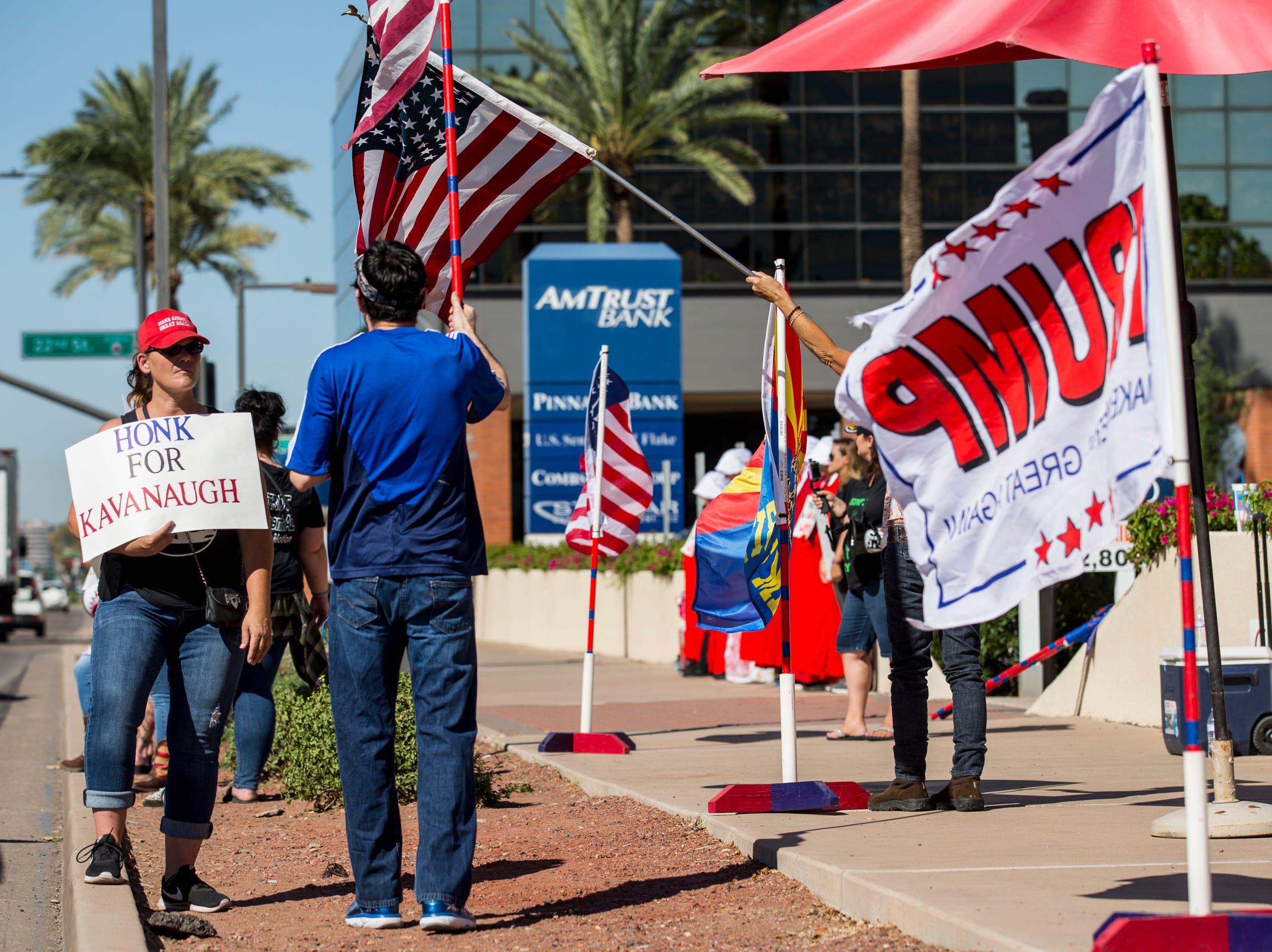 Supporters of Supreme Court nominee Brett Kavanaugh protest outside Sen. Jeff Flake's office  on Sept. 27, 2018, in Phoenix.