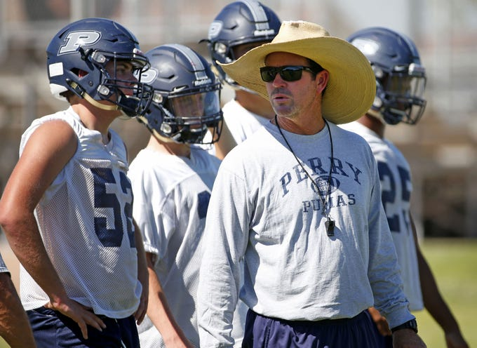 Perry High football coach Preston Jones instructs his team during practice in Gilbert on September 26,  2018.