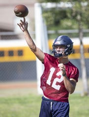 Perry High football quarterback Chubba Purdy, (12) passes the ball during practice in Gilbert on September 26,  2018.